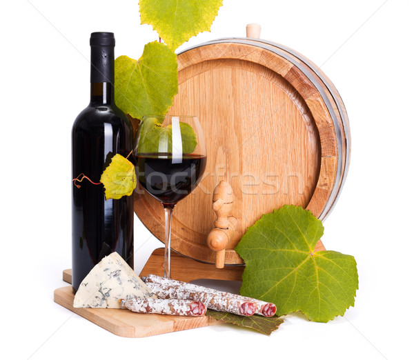 Red wine with cheese snack and little barrel Stock photo © icefront