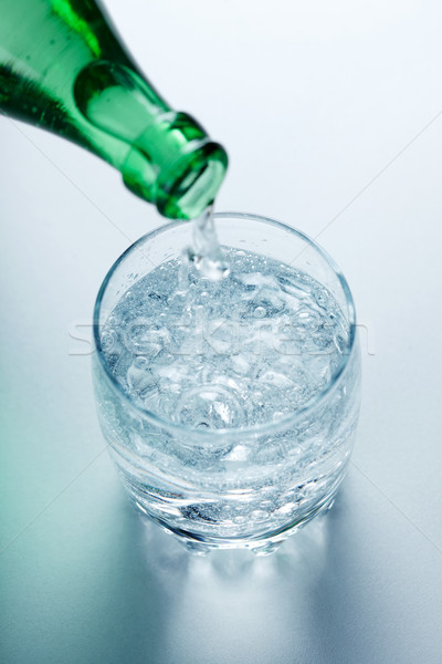 Stock photo: Mineral water pouring into glass