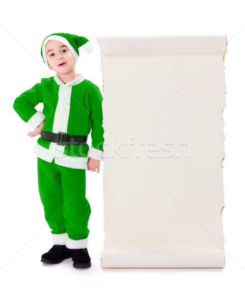 Little green Santa Claus standing near big wish list Stock photo © icefront