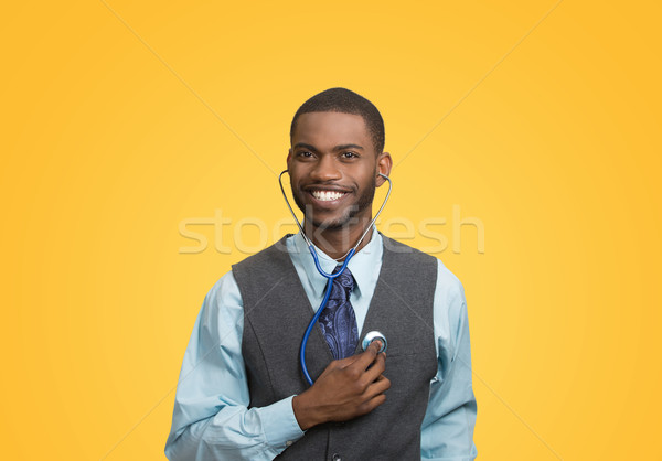 Executive man listening  to his heart, self criticism concept Stock photo © ichiosea