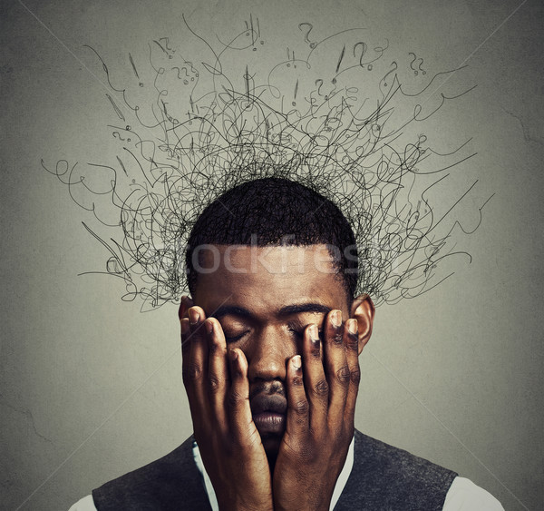 Depressed man with worried desperate stressed expression and brain melting into lines Stock photo © ichiosea