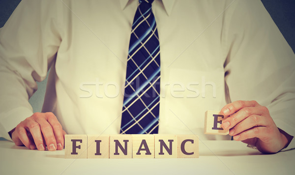 Financial market concept. Businessman hands arranging wooden blocks with word finance Stock photo © ichiosea