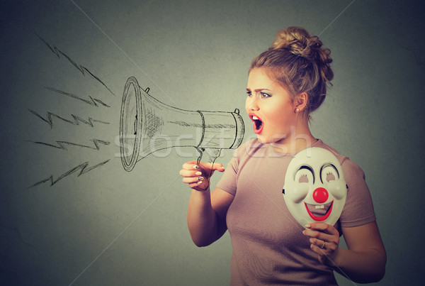 woman with clown mask screaming in megaphone Stock photo © ichiosea