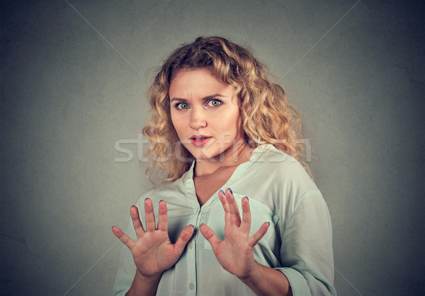 scared woman raising hands up in defense  Stock photo © ichiosea