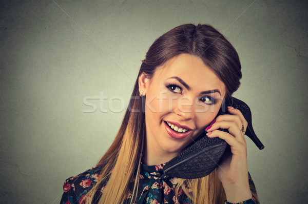 Woman using her shoe as phone Stock photo © ichiosea
