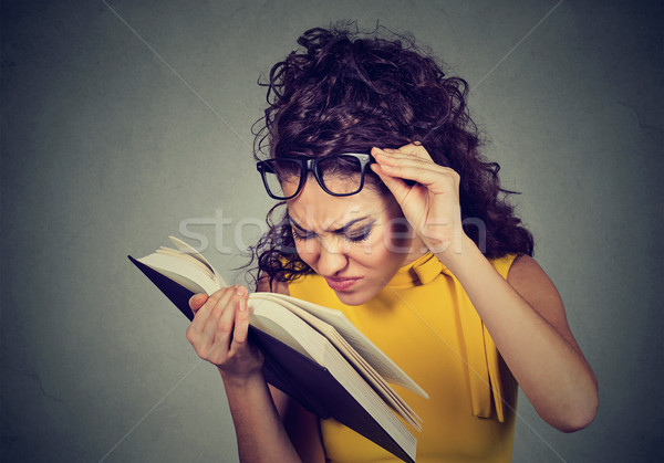 Woman with glasses reading book has eyesight problems Stock photo © ichiosea