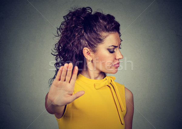 annoyed angry woman with bad attitude giving talk to hand gesture Stock photo © ichiosea