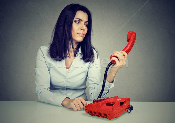 Confused woman receiving bad news over the telephone  Stock photo © ichiosea