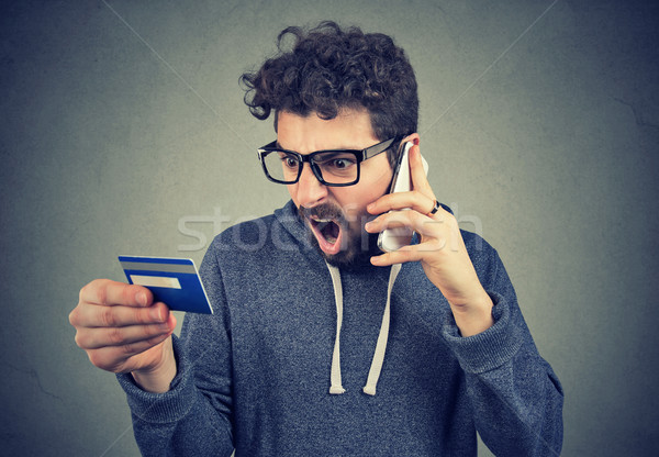 Screaming angry man solving problems with credit card Stock photo © ichiosea