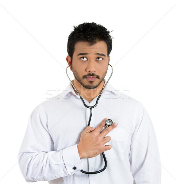 man listening to his own heart beat Stock photo © ichiosea