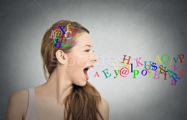 woman talking, alphabet letters in her head and coming out of mouth Stock photo © ichiosea