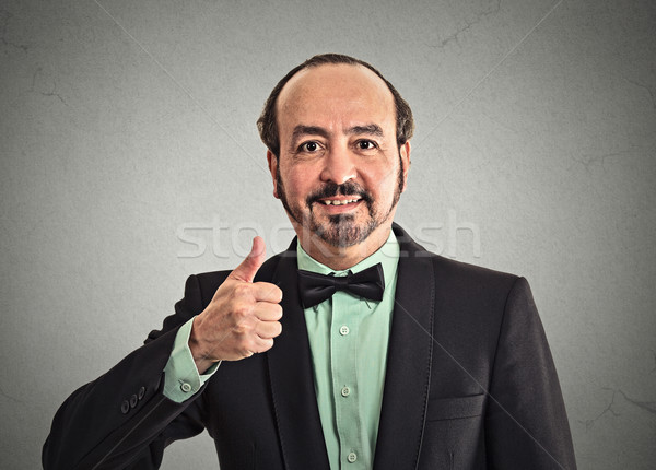 businessman giving thumbs up  Stock photo © ichiosea
