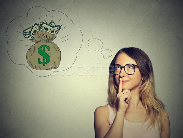 Woman dreaming of financial success  Stock photo © ichiosea
