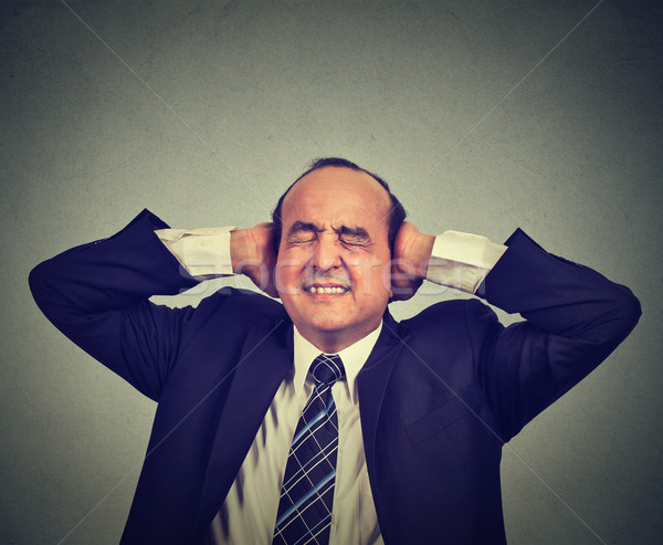 Stressed man upset frustrated has too many thoughts headache  Stock photo © ichiosea