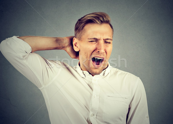 sleepy man yawning stretching arms back. Sleep deprivation Stock photo © ichiosea