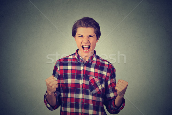 successful student, man with fists pumped Stock photo © ichiosea
