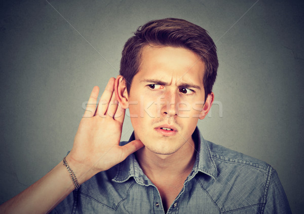 hard of hearing man placing hand on ear listening to gossip  Stock photo © ichiosea