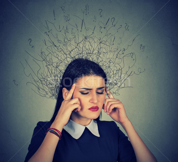 sad young woman with worried stressed face expression Stock photo © ichiosea