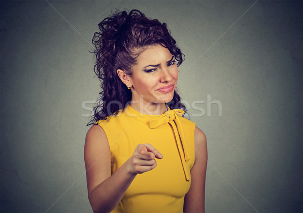 angry woman pointing finger at camera Stock photo © ichiosea