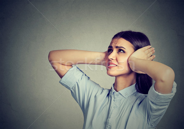 Stressed frustrated woman covering her ears with hands.  Stock photo © ichiosea