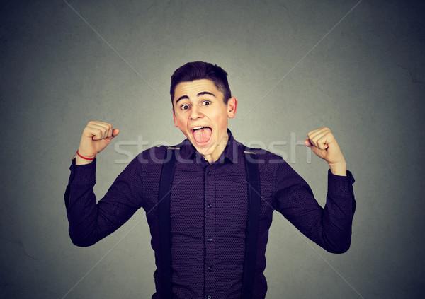 Successful man winning, pumping fists Stock photo © ichiosea