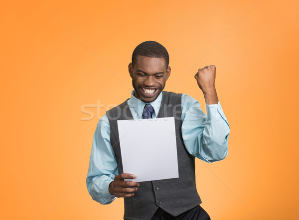 Stock photo: Excited happy man holding document, receiving goood news