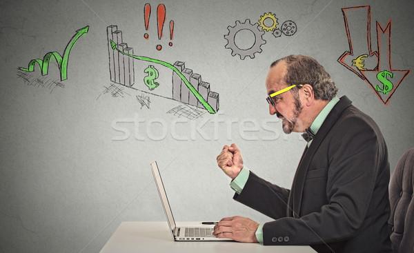 Upset angry man working on computer  Stock photo © ichiosea