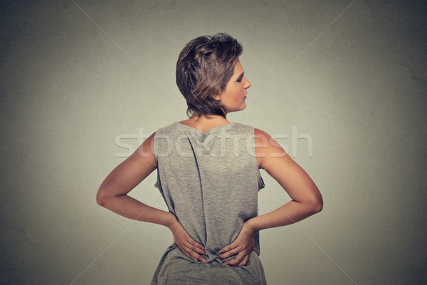 young woman standing with backache back pain  Stock photo © ichiosea