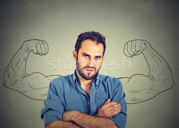 sport young man with huge, fake, muscle arms drawn on the chalkboard  Stock photo © ichiosea