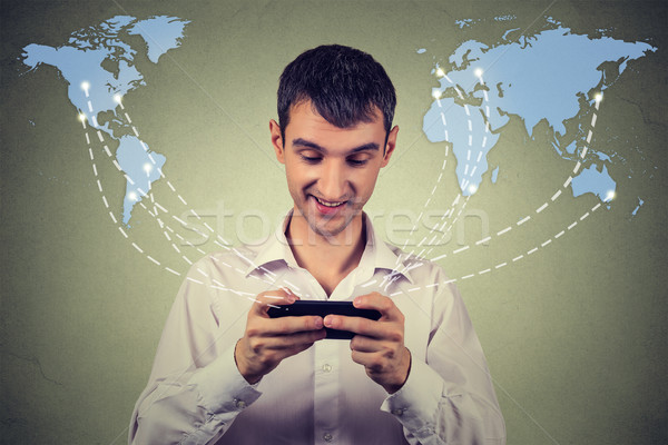 business man holding smartphone connected browsing internet worldwide  Stock photo © ichiosea