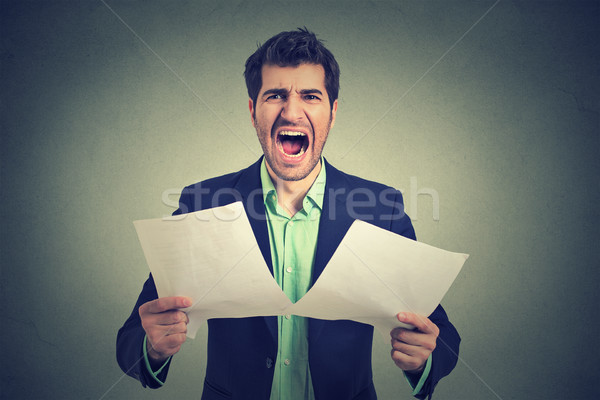 Angry stressed screaming business man with documents papers paperwork Stock photo © ichiosea