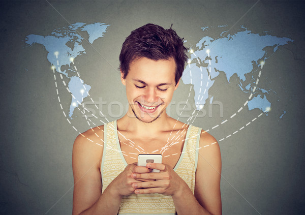 Happy man holding smartphone connected browsing internet Stock photo © ichiosea
