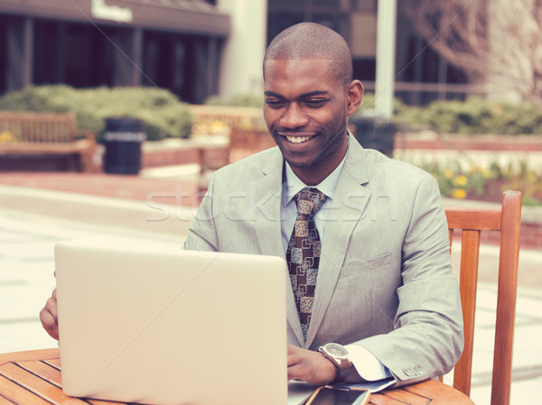 businessman working on his laptop outdoors corporate office Stock photo © ichiosea