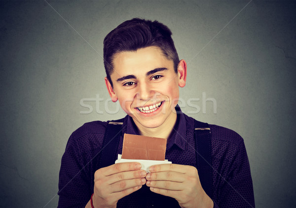 Portrait of a young chocolate loving man  Stock photo © ichiosea