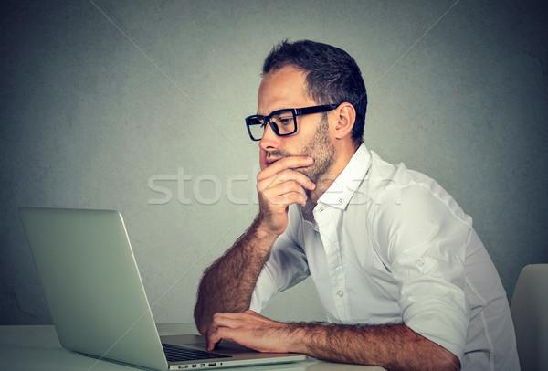 Man working using laptop computer  Stock photo © ichiosea