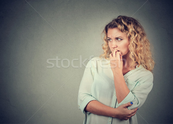 Portrait anxious woman biting her fingernails craving for something Stock photo © ichiosea