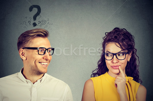 Does she like me? Man with question mark looking at an attractive girl flirting with him Stock photo © ichiosea