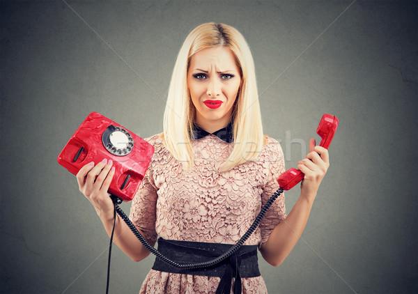 Karışık rahatsız kadın eski moda telefon genç kadın Stok fotoğraf © ichiosea