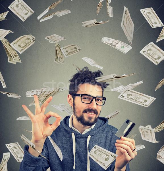 Content man having money compensation Stock photo © ichiosea