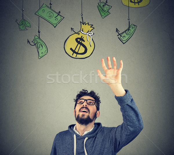 Hipster man trying to grab a sack of money  Stock photo © ichiosea