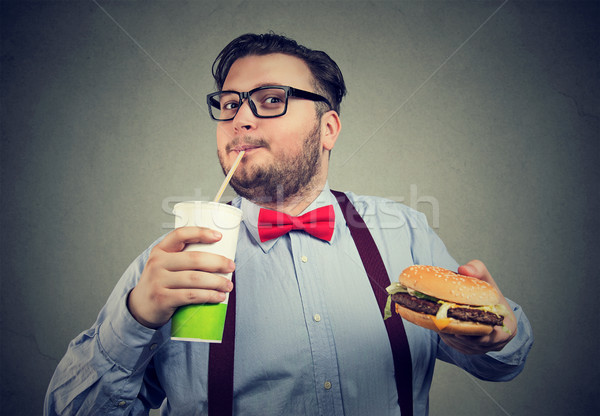Excited overweight man eating fast food Stock photo © ichiosea