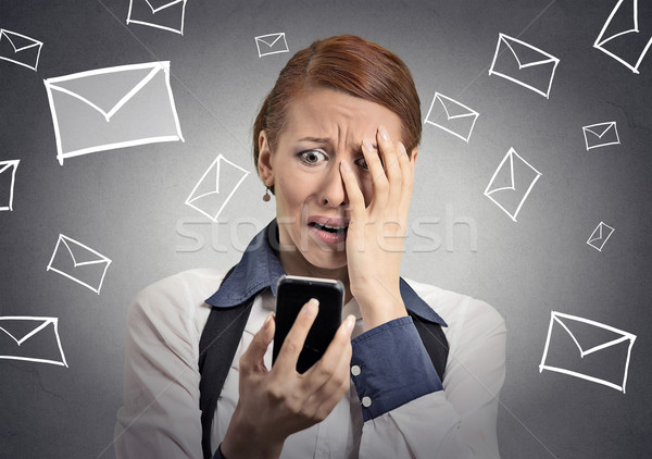 stressed woman shocked with message on smartphone  Stock photo © ichiosea