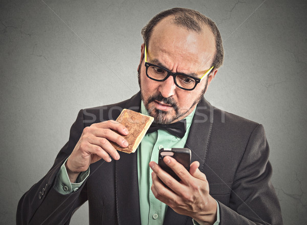 man reading message on smart phone eating cookie  Stock photo © ichiosea