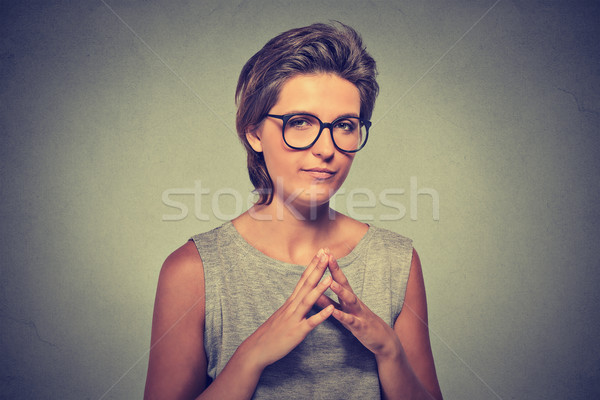 sneaky, sly, scheming young woman in glasses trying to plot something Stock photo © ichiosea