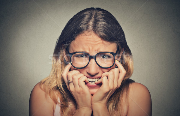stressed anxious young woman girl in glasses student biting fingernails Stock photo © ichiosea