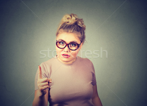 angry woman with finger pointing up looking displeased Stock photo © ichiosea