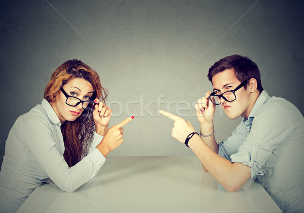 man woman pointing fingers at each other blaming each other  Stock photo © ichiosea