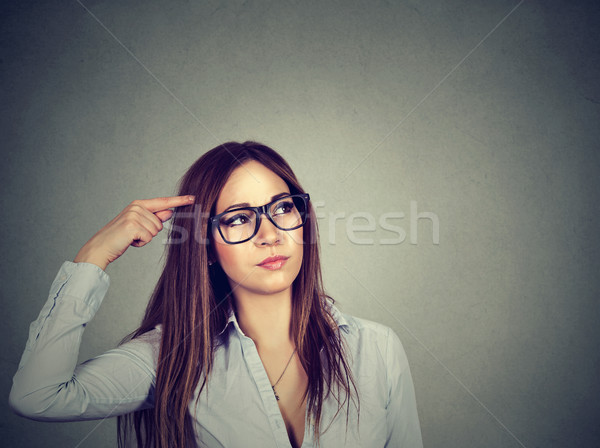 confused thinking woman bewildered scratching head seeks solution  Stock photo © ichiosea