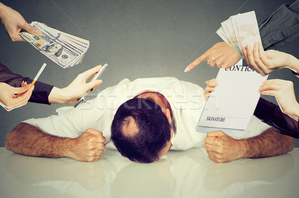 Tired stressed man employee overwhelmed by things to be done  Stock photo © ichiosea