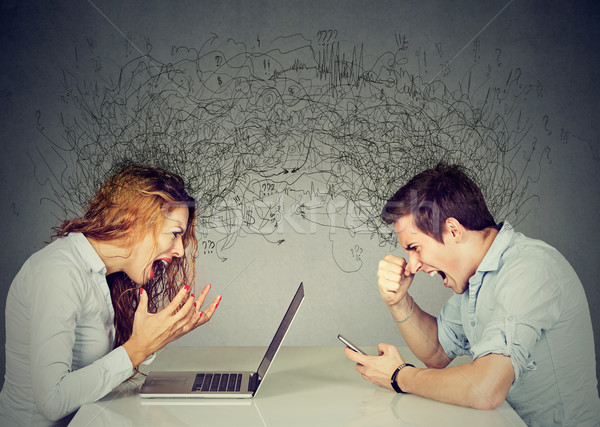 Stressed business woman screaming at laptop sitting at table across angry man shouting at mobile pho Stock photo © ichiosea